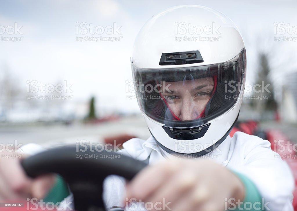 Go-cart driver looking at camera stock photo
