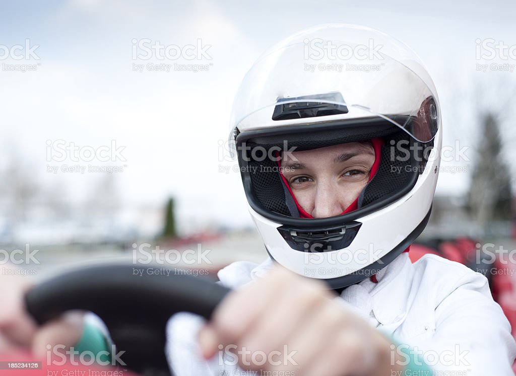 Go-cart racing driver with visor up stock photo