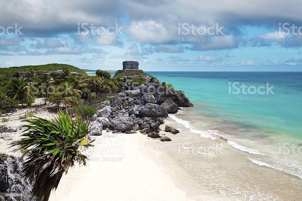 God of Winds Temple guarding Tulum's sea entrance bay stock photo