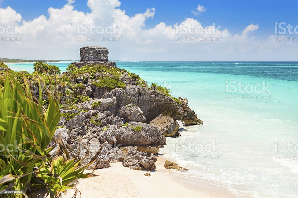 God of Winds Temple on Caribbean beach with turquoise water stock photo