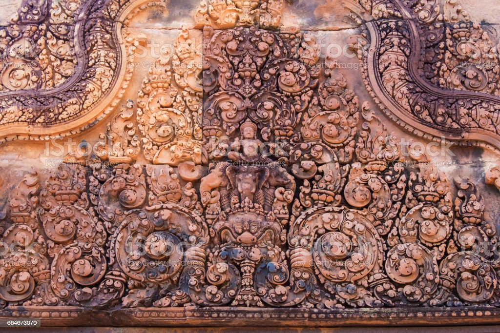 God Siva carved on stone, Banteay Srei temple (Cambodian temple dedicated to the Hindu god Shiva) stock photo