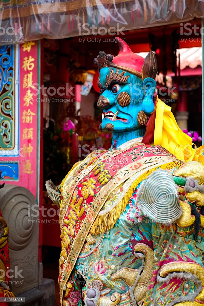 God statue in traditional old oriental chinese temple in Taiwan stock photo