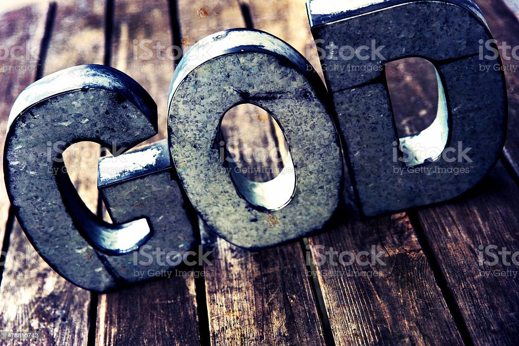 God text on a Retro Wooden Table stock photo