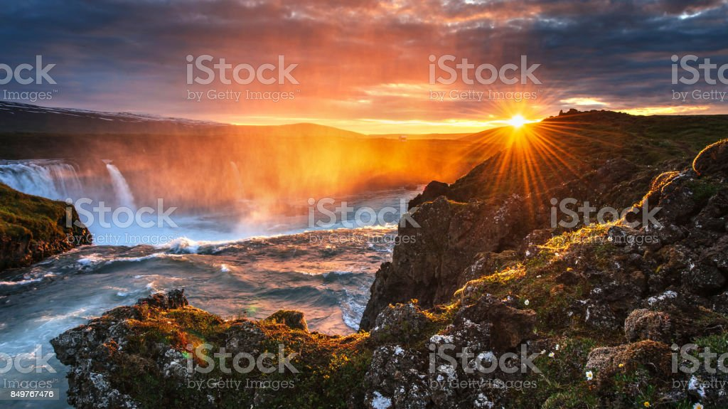 Godafoss waterfall at sunset. Fantastic landscape. Beautiful cumulus clouds. stock photo