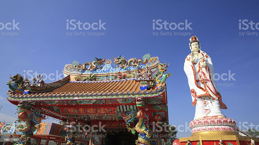 Goddess of Mercy statue and Chinese temple roof royalty-free stock photo