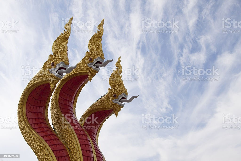 Goden three headed naga statue stock photo