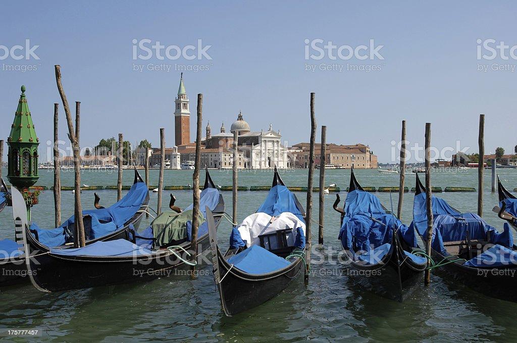 Godolas at Saint Mark's Square and San Giorgio Maggiore island royalty-free stock photo