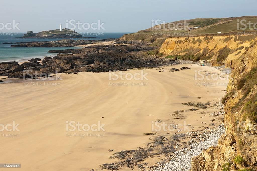 Godrevy lighthouse and part of deserted Hayle beach in Cornwall stock photo