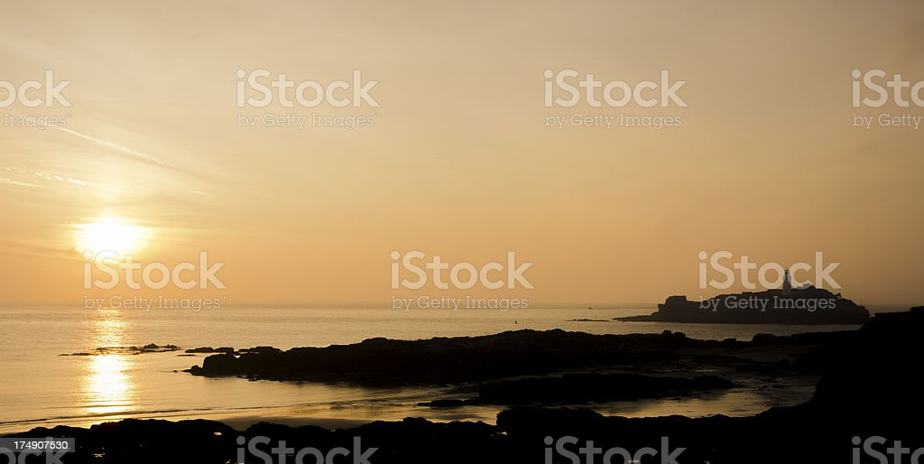 Godrevy Lighthouse at sunset. stock photo