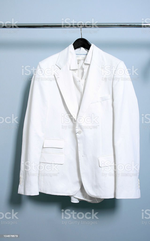 God's Closet - Solitary White Suit Hanging on a Rack royalty-free stock photo