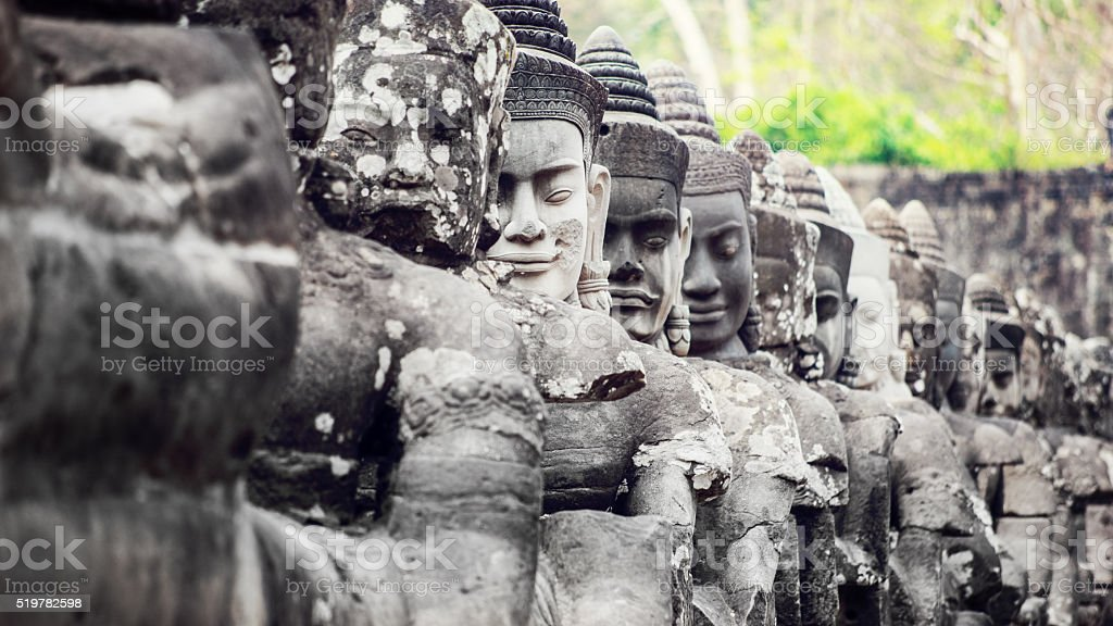 Gods of the South Gate of Angkor Thom, Cambodia stock photo