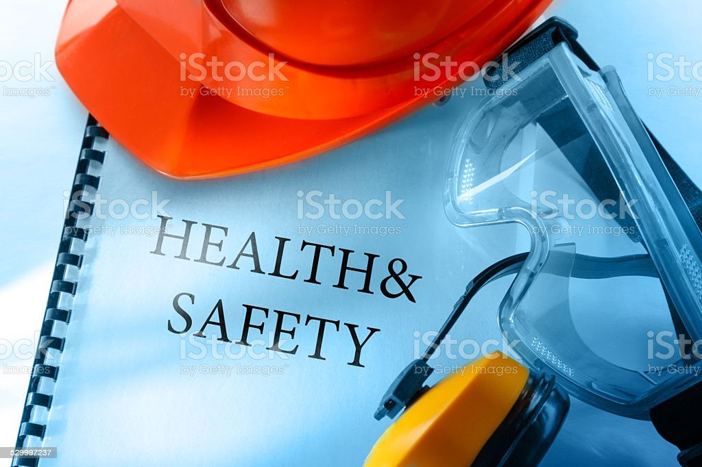 Goggles, earphones and red helmet stock photo