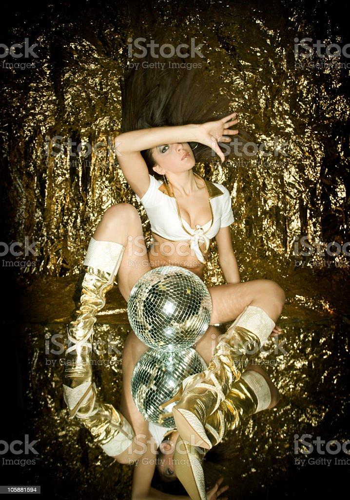 Gogo dancer in gold royalty-free stock photo