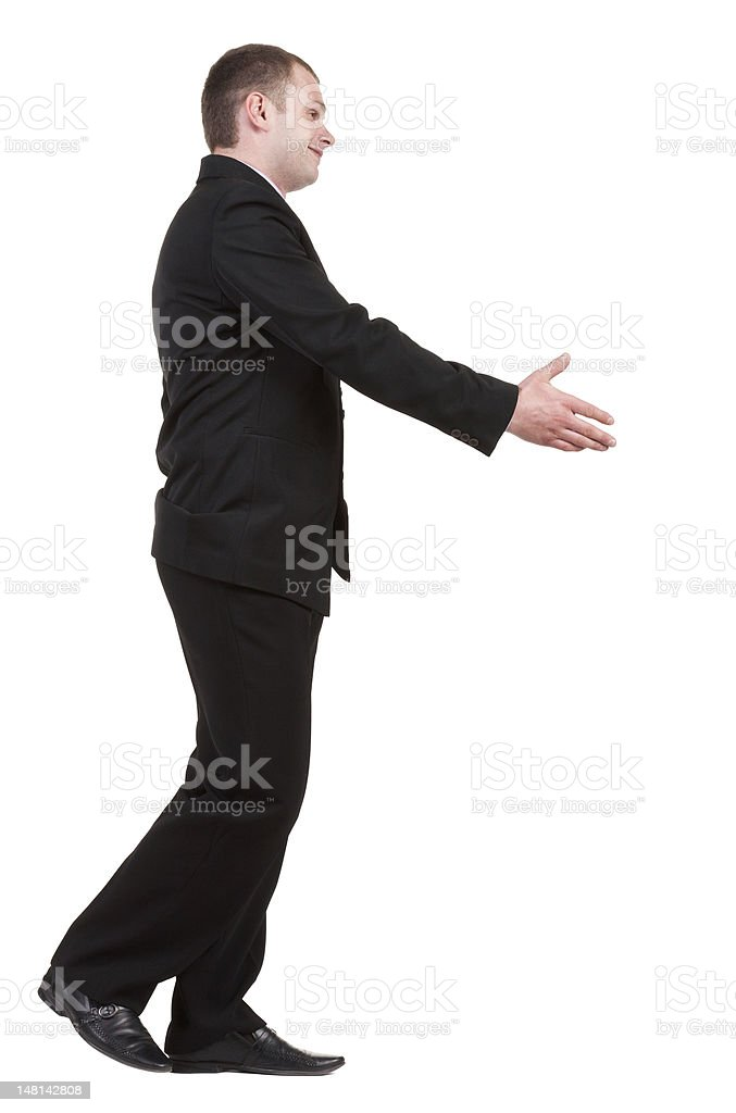 going businessman  in black suit  handshake. royalty-free stock photo