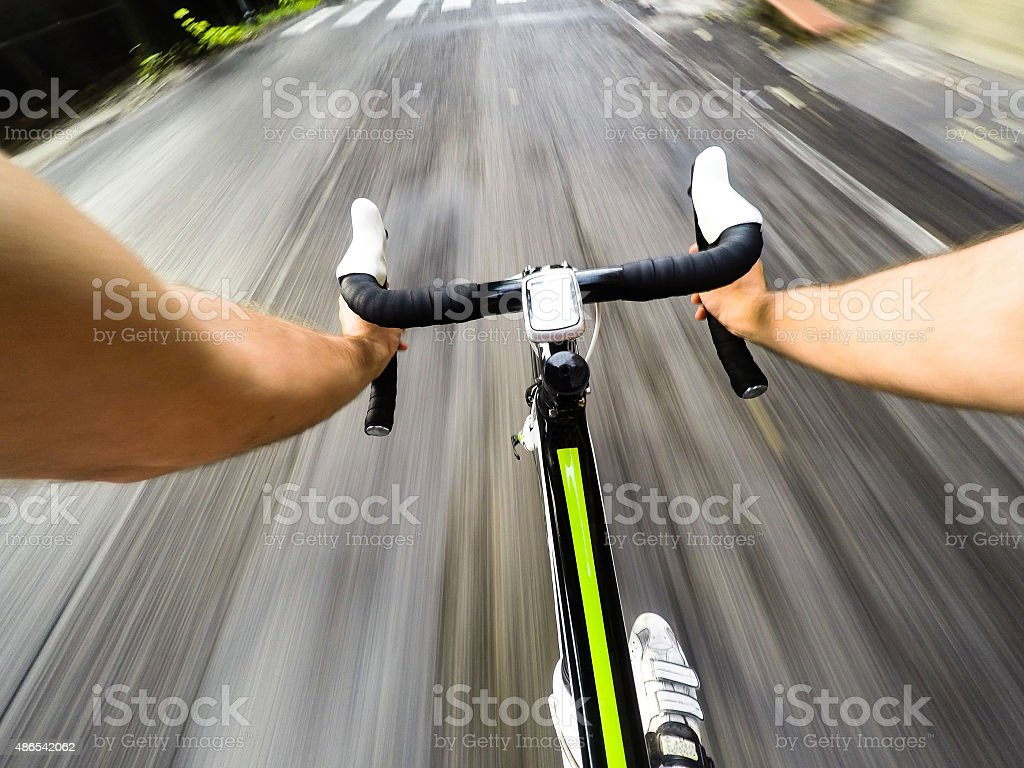 Going Down with Bicycle on the Road. pov stock photo