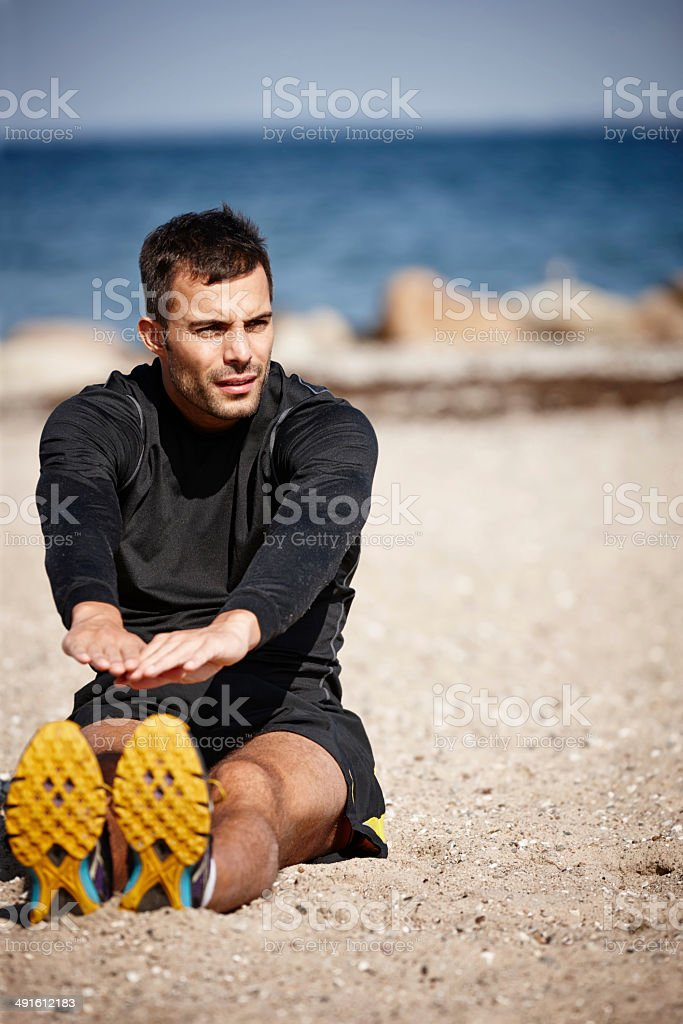 Going for a run...but not before stretching stock photo
