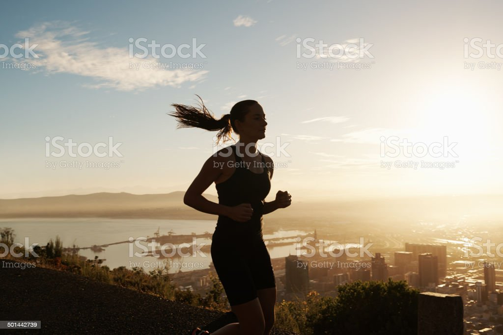 Going for a serene early run stock photo