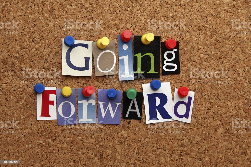 Going forward pinned on noticeboard royalty-free stock photo