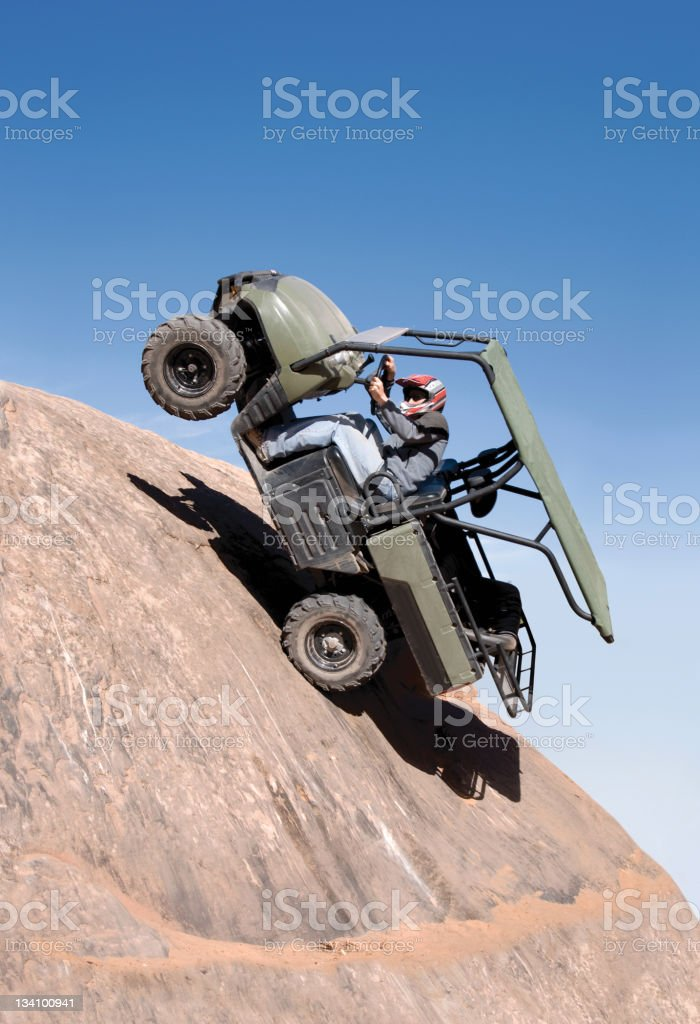 ATV going hey Rocky Hill on two back wheels royalty-free stock photo