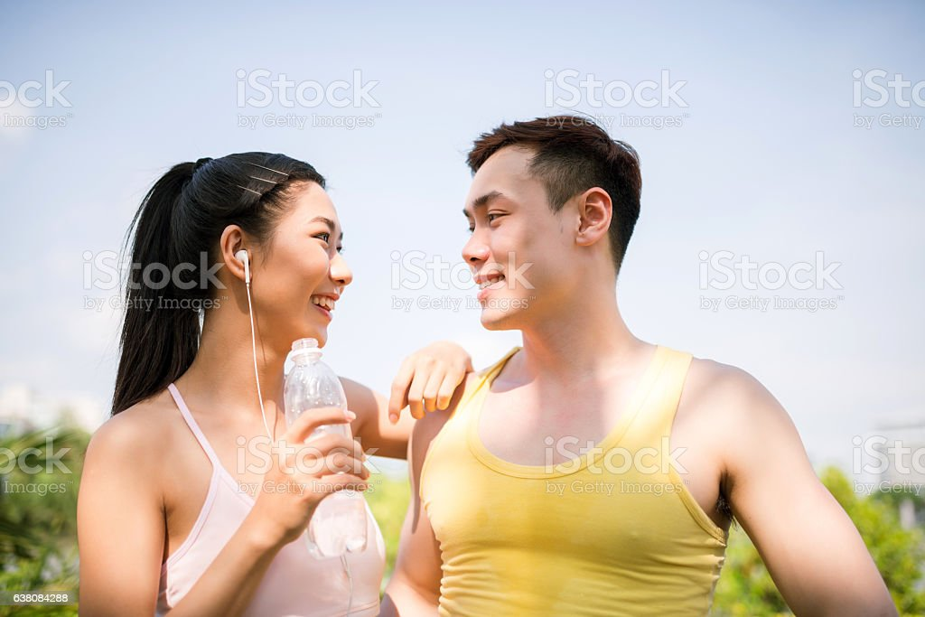 Going in for sport together stock photo