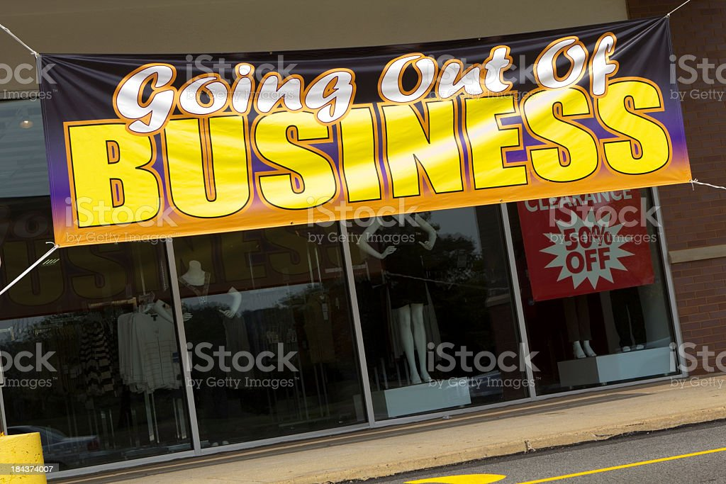 Going Out Of Business sign on store front stock photo