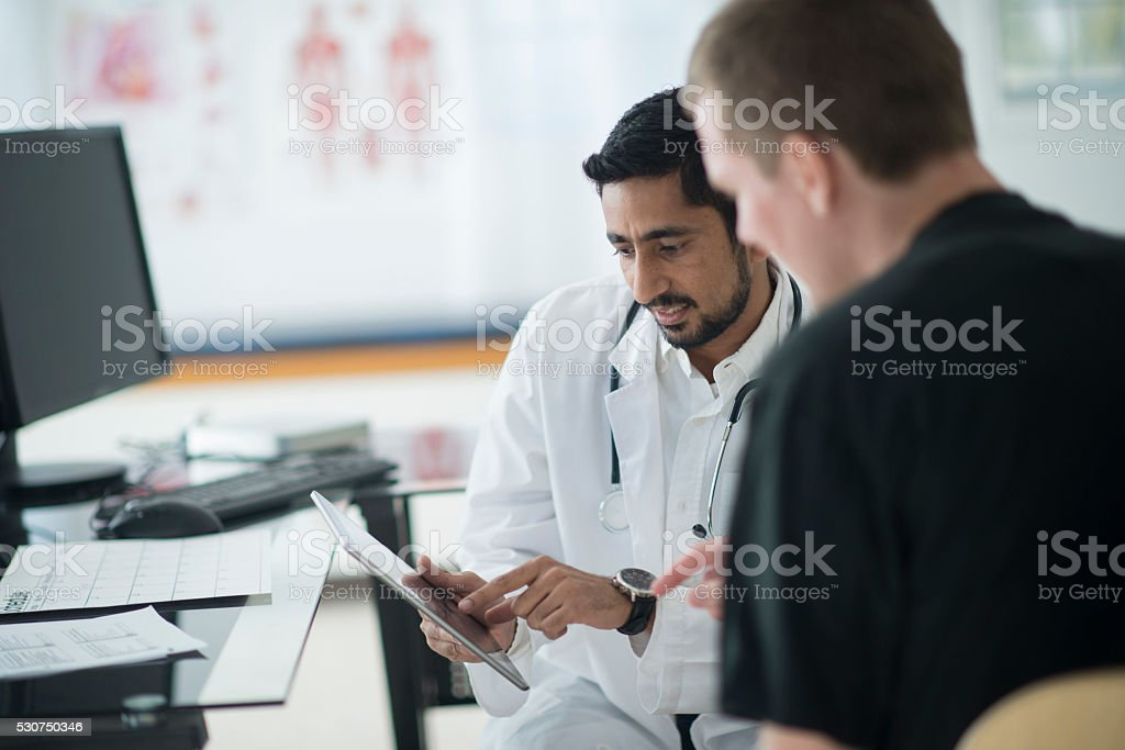 Going Over a Patients Charts stock photo