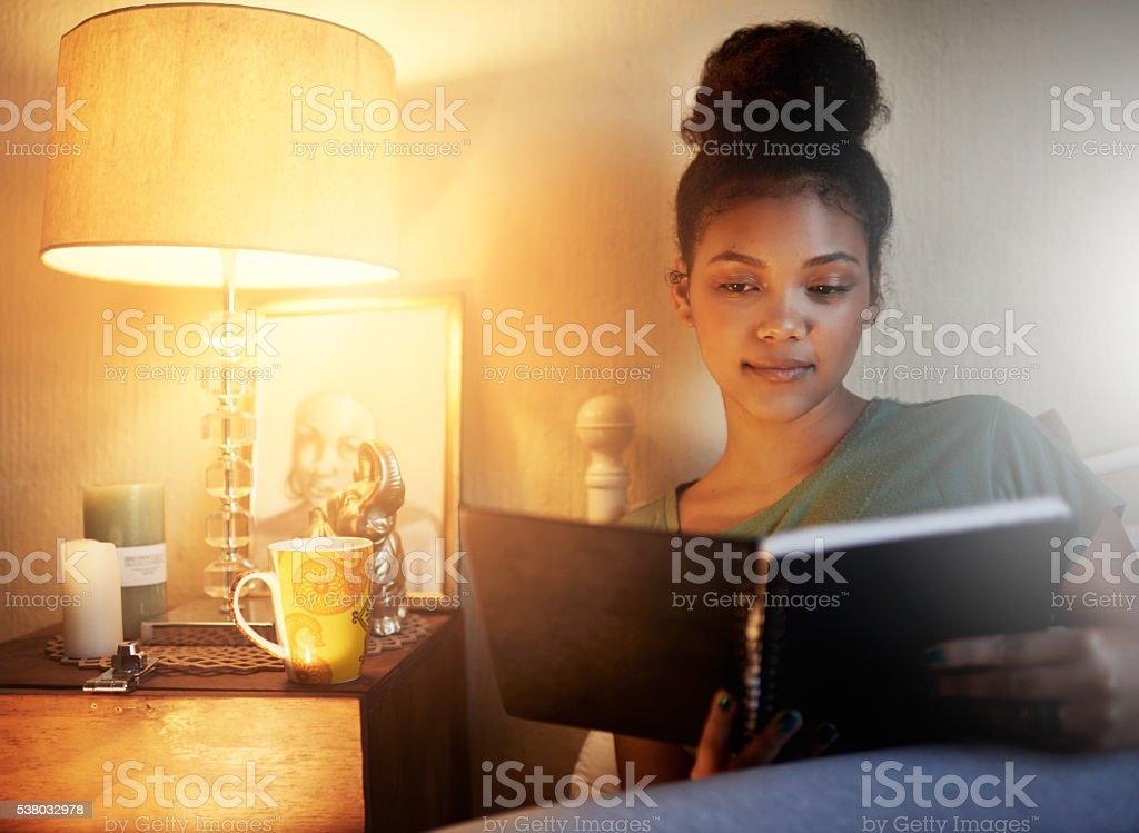 Going over her study notes stock photo