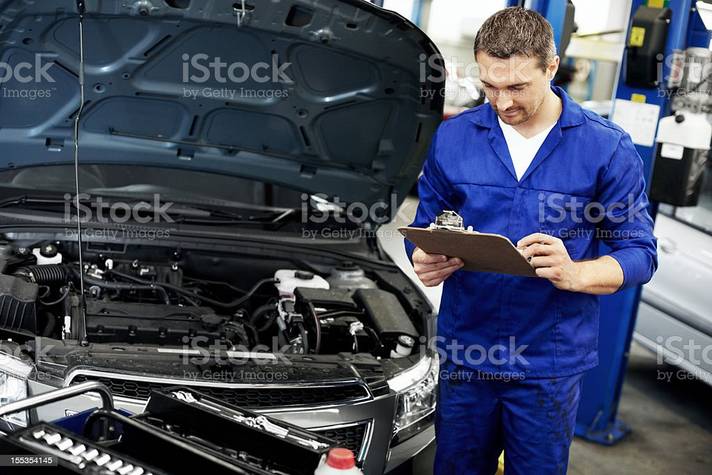 Going over his notes so he doesn't miss a thing royalty-free stock photo