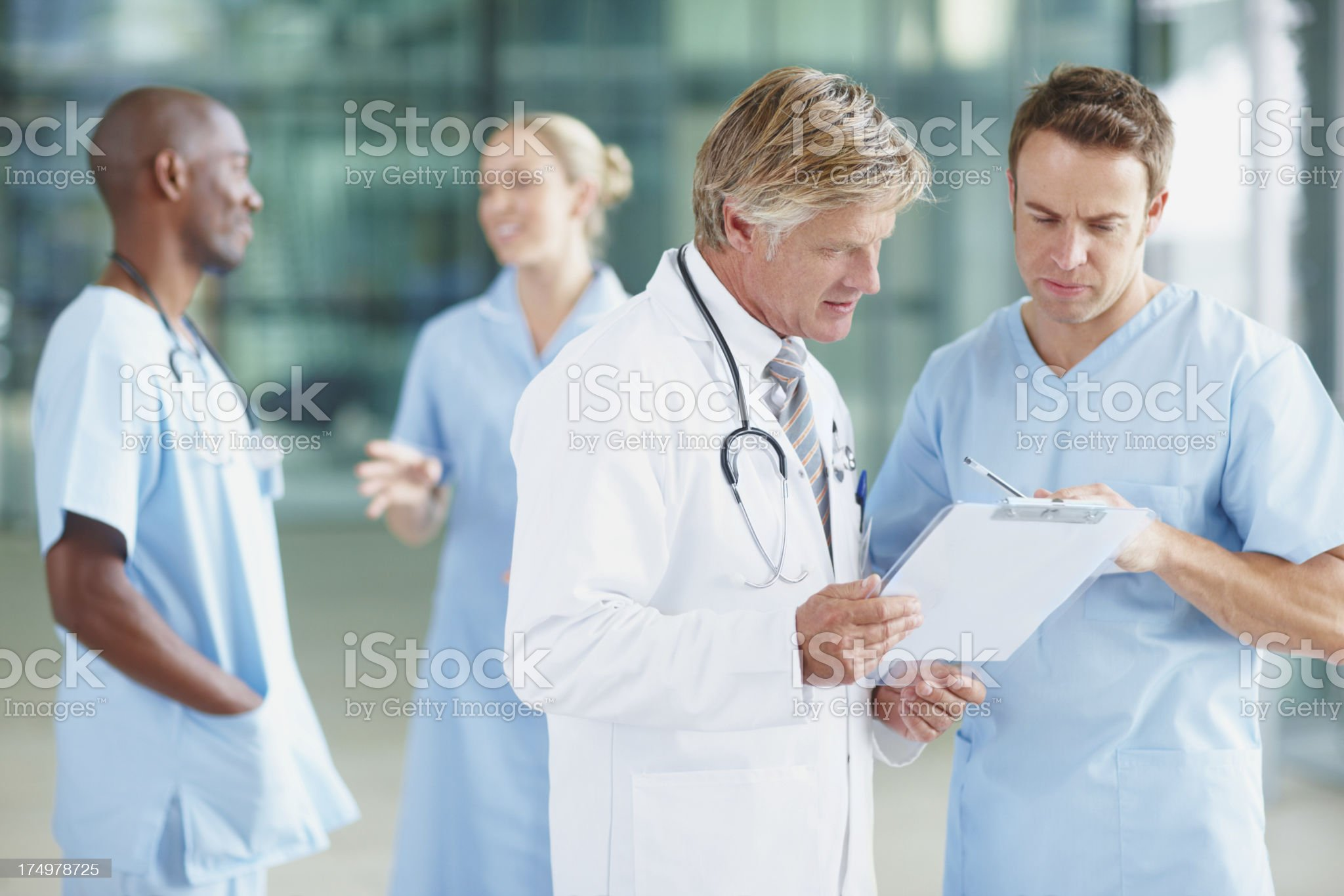 Going over patient progress reports royalty-free stock photo