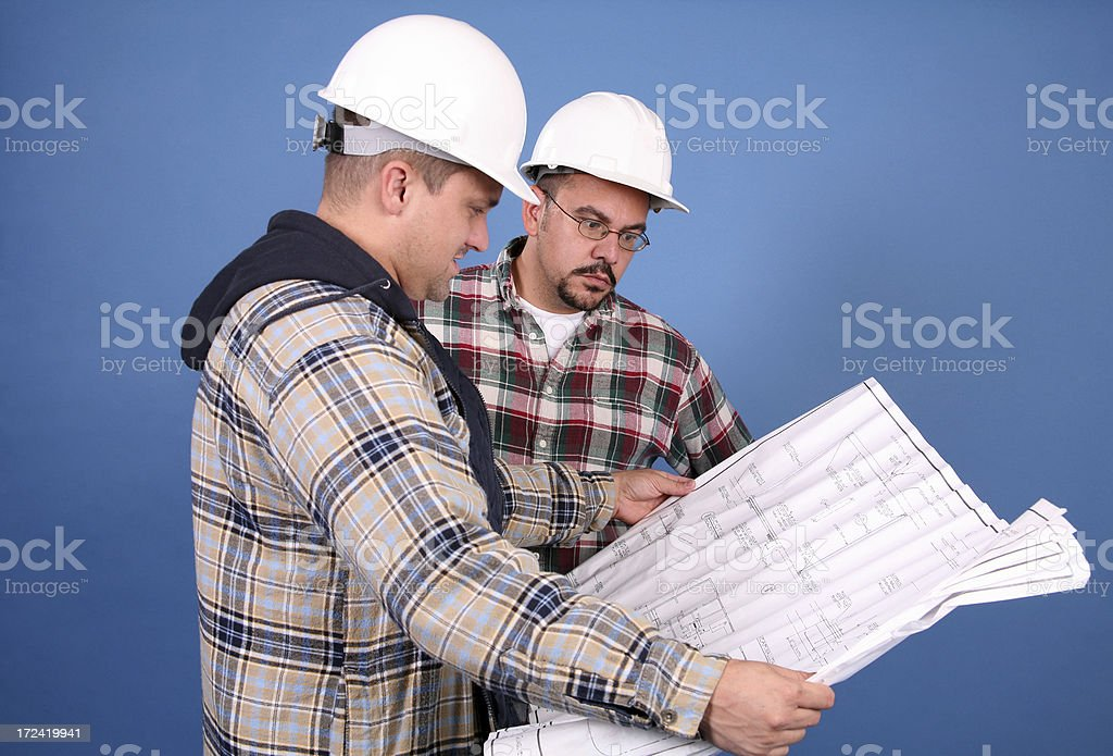 Going Over the Plan stock photo