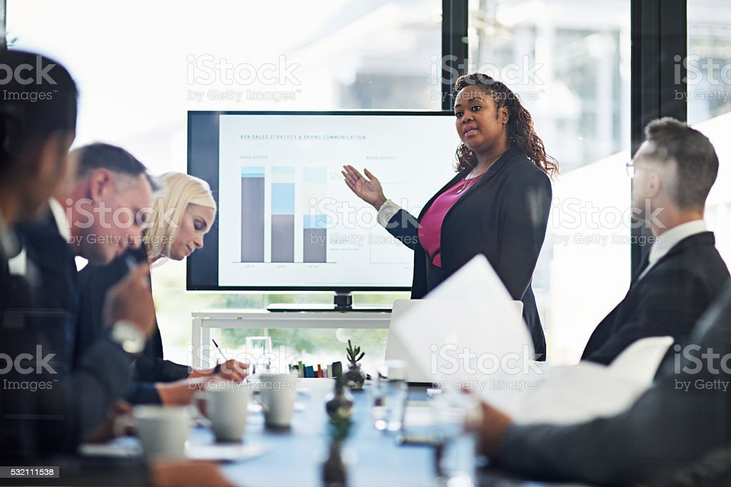 Going over the quarterly figures stock photo