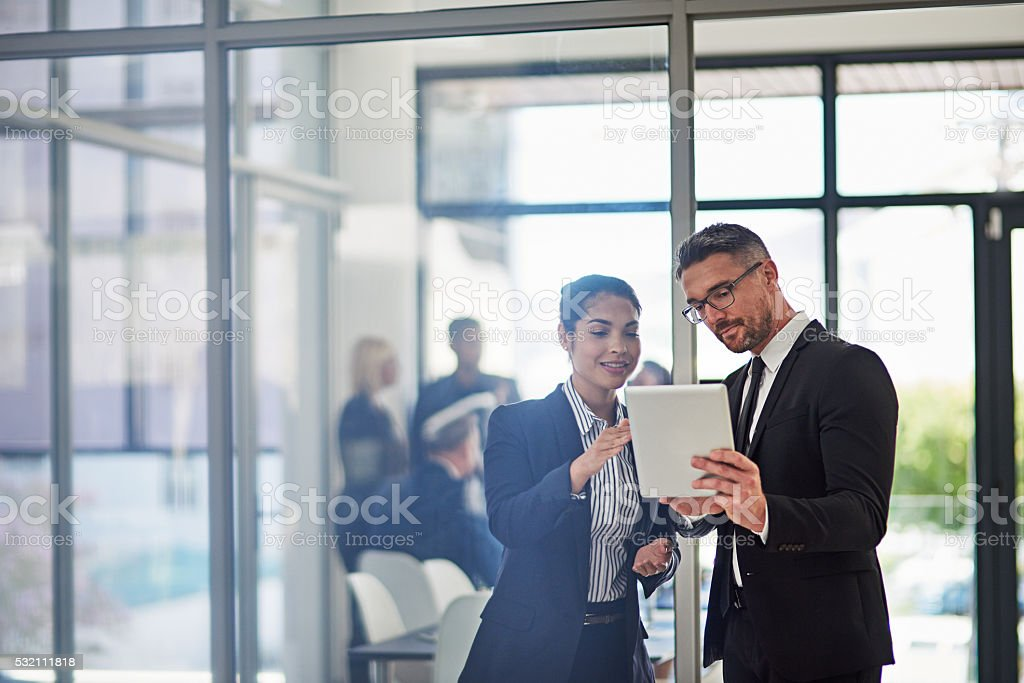 Going over their facts and figures stock photo