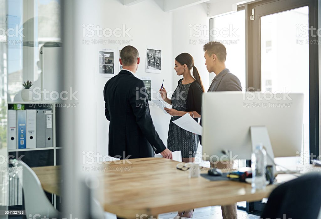 Going over their strategy stock photo