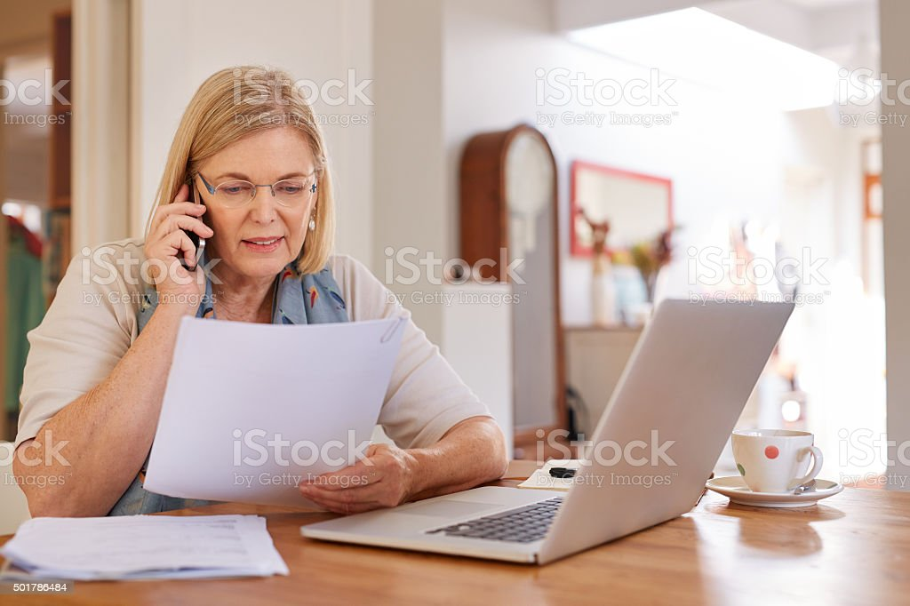 Going through her financial statements stock photo