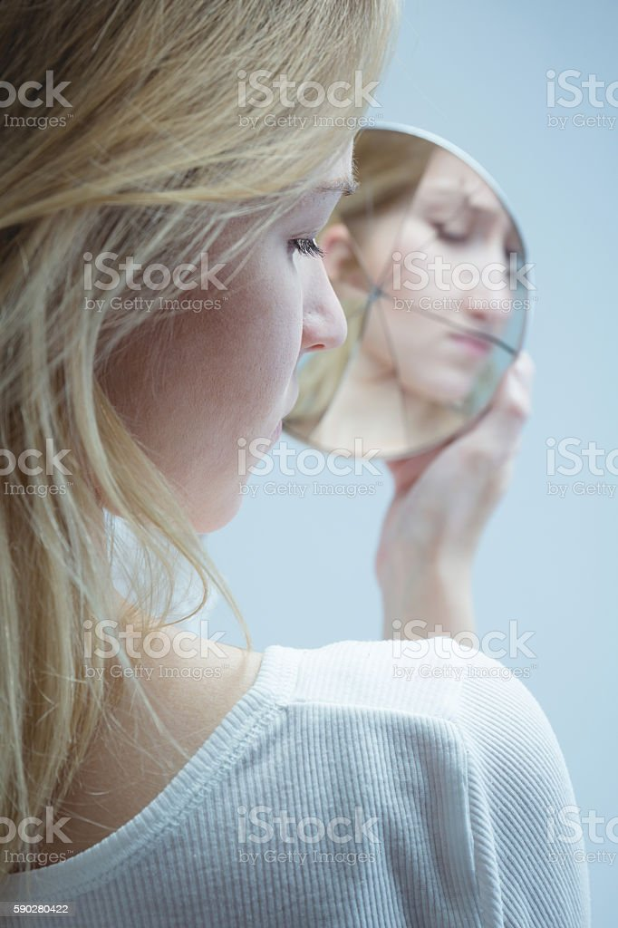 Going through painful moments in her life stock photo