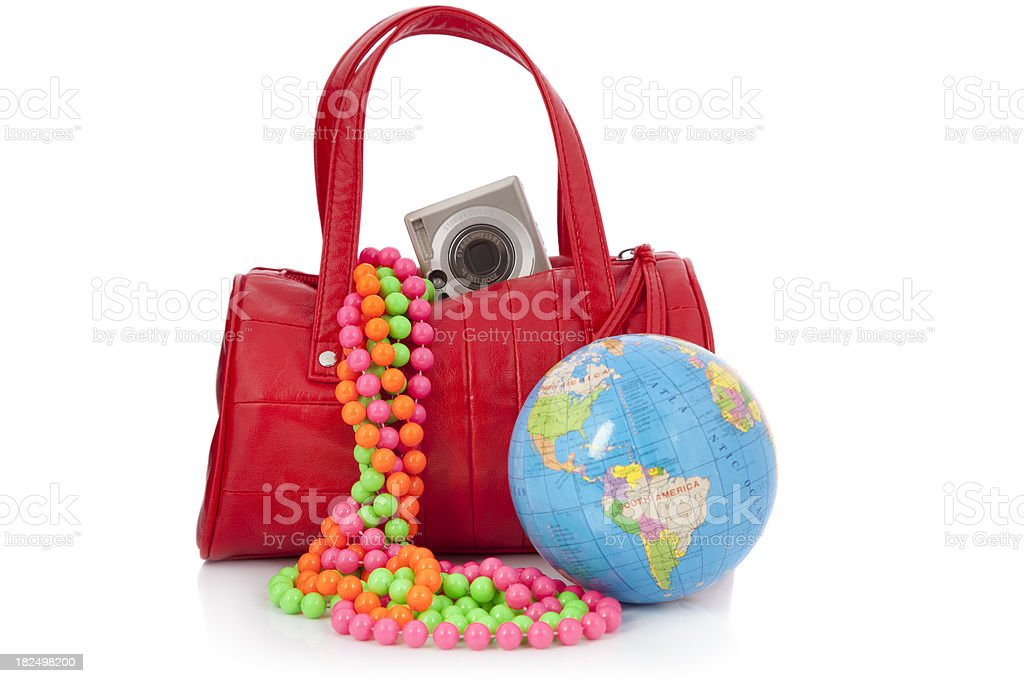 Going to Mardi Gras - Red bag, camera and world royalty-free stock photo