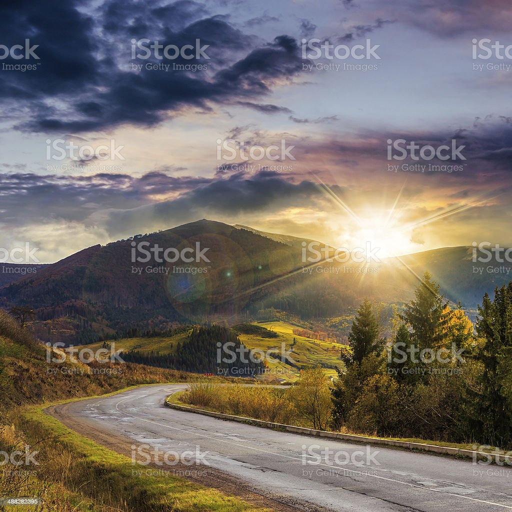 going to mountains at sunset stock photo