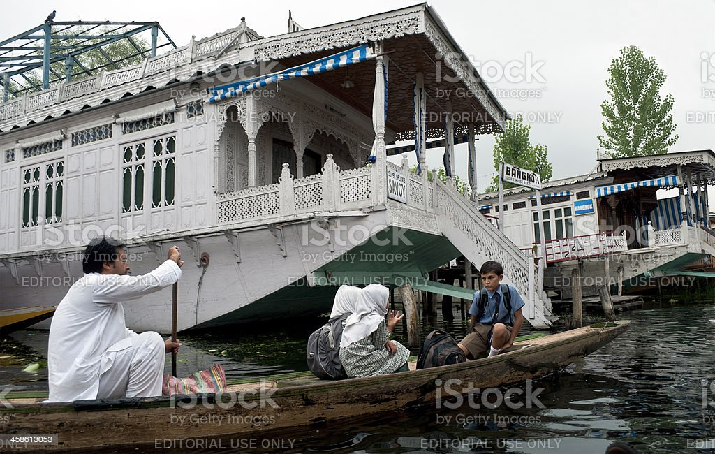 Going to School in Boat Lake Dal India royalty-free stock photo