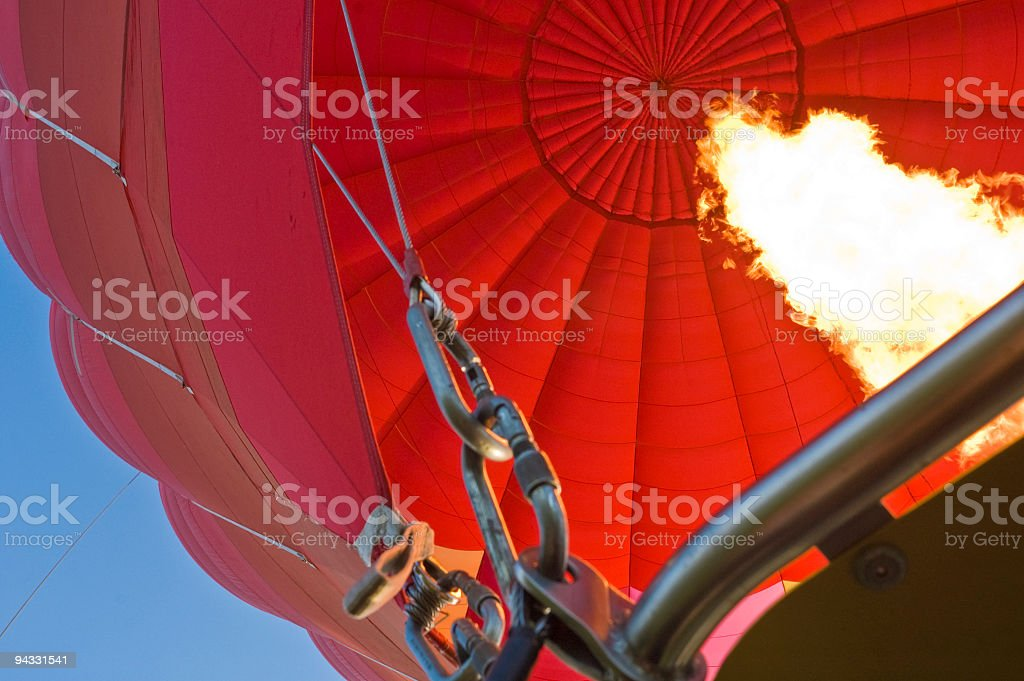 Going up in a red balloon royalty-free stock photo