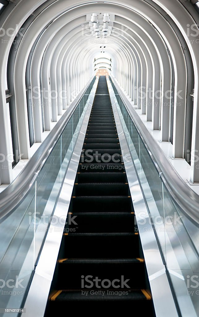Going Up: Long Escalator stock photo
