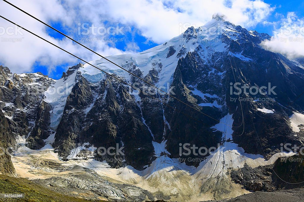 Going up to Aiguille Du Midi, Mont Blanc above clouds stock photo