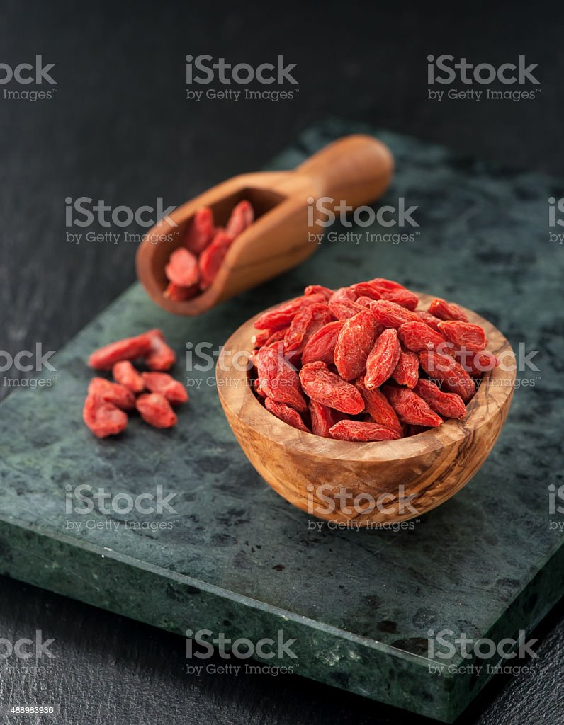 Goji berries in a bowl close up stock photo