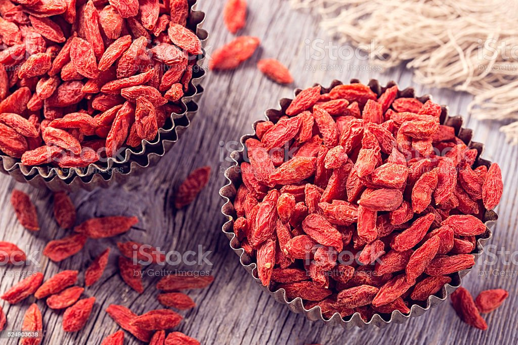 Goji berries in a bowl stock photo