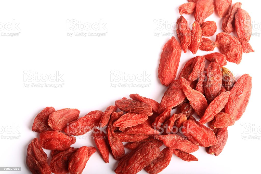 goji berries isolated on white background stock photo