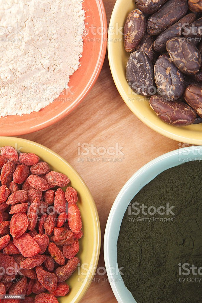 Goji Berries, Maca, Spirulina, Cacao royalty-free stock photo