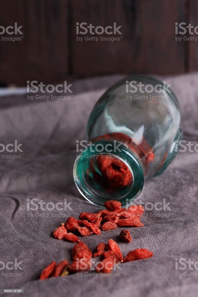 goji berries on a dark linen background selective soft focus stock photo