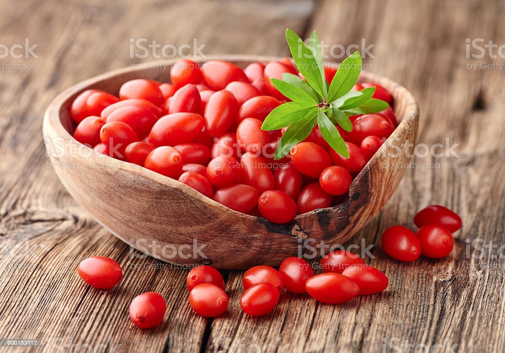 Goji berries on a wooden board stock photo