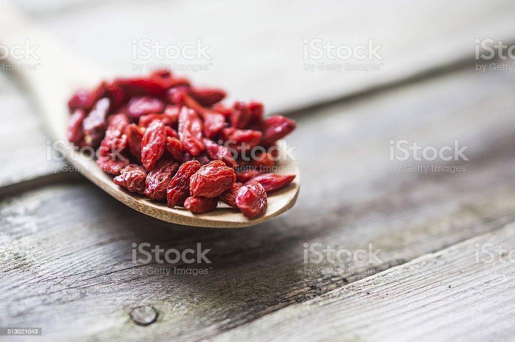 Goji berries on wooden background stock photo