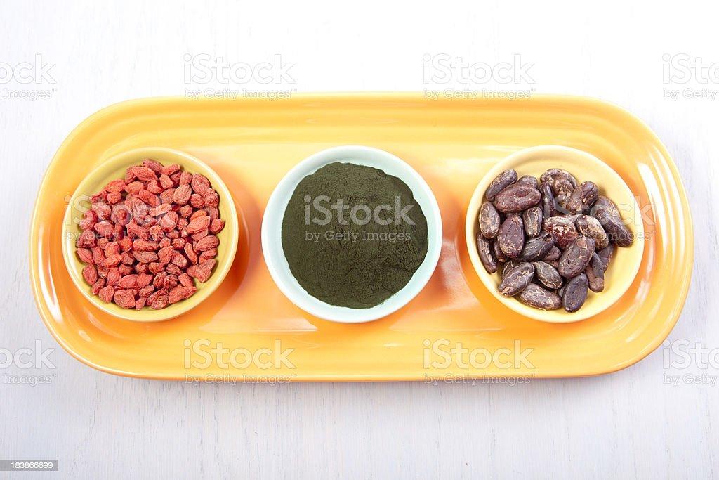 Goji berries, Spirulina, Cacao royalty-free stock photo