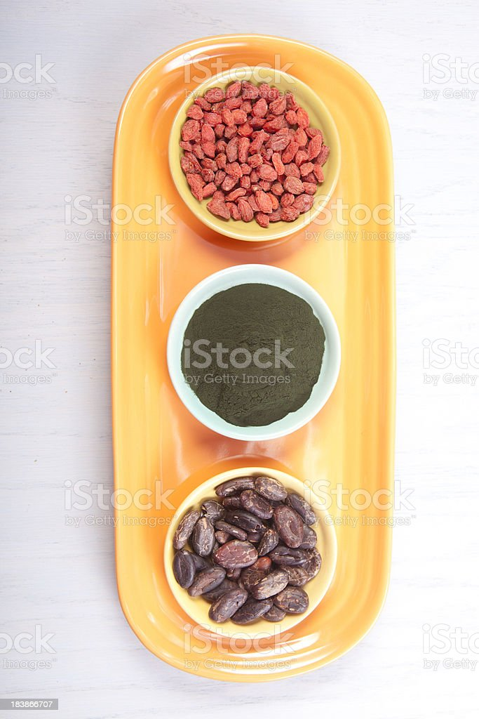 Goji berries, Spirulina, Cacao royalty-free stock photo